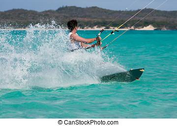 Kitesurf in the lagoon - Male kitesurfer kitesurfing in the...
