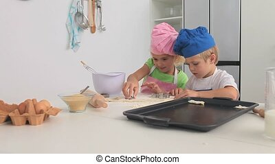 Adorable children cooking in the kitchen
