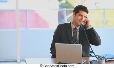 Businessman talking on the phone - Handsome businessman...