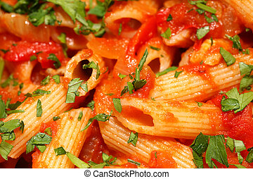 Penne rigate pasta with tomato sauce background