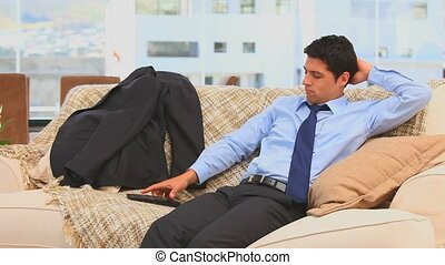 Businessman watching tv in the living room