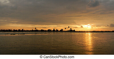 Orange sunset in Kerala India - Orange sunset on the...
