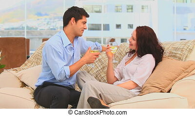 Attractive couple celebrating - Casual man working on his...