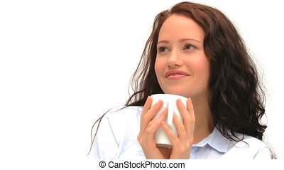 Woman drinking a cup of coffee against a white background
