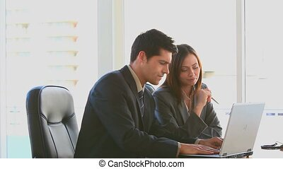 Businessman and woman working on a