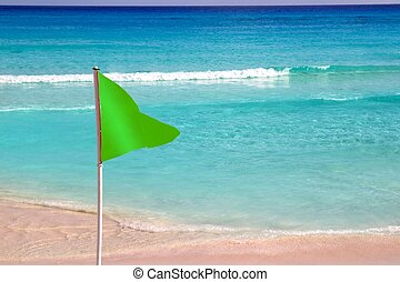 Green beach flag good beach weather - Green beach flag in...