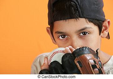 Young Baseball Player - Young Hispanic male with baseball,...