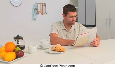 Man reading the newspaper