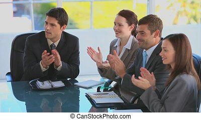 Businessteam clapping their hands during a meeting