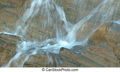 Cascading waterfalls - Tumbling waters descending rock wall