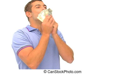 Man counting and kissing his money