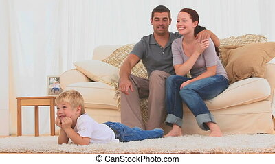 Lovely family watching the tv in the living room