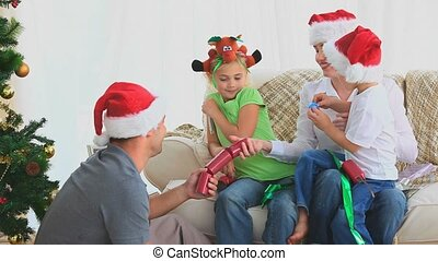 Family Christmas with crackers in the living room