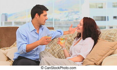 Couple drinking wine in the living room at home