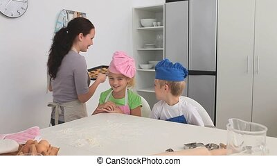 Cute children eating what they cooked in the kitchen