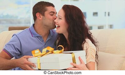 Man offering a present to his lovely girlfriend