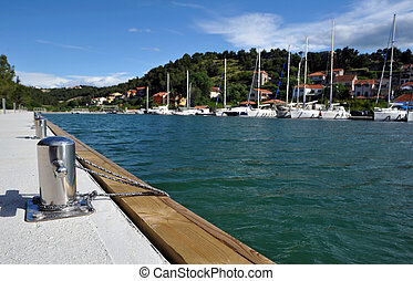 Stainless steel bitt at marina of Skradin, Croatia