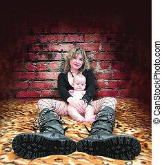mother and daughter - a young woman in high boots sits on a...