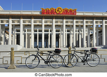Two bikes in front of the National Museum of Chinese History...