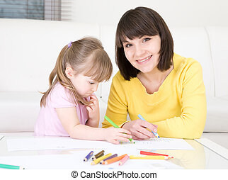 kindergarden - young mother and her daughter having fun in...