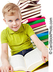 Want to know everything - Portrait of a boy sitting with a...