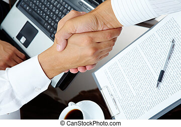 Handshake - Photo of handshake of business partners after...