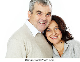 Spouses - Portrait of a happy senior couple standing...