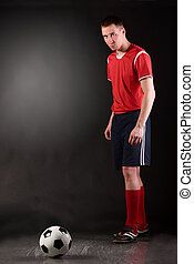 soccer player in dark - soccer player is preparing for free...