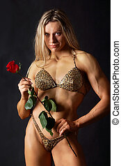 Strong woman with a rose - Portrait of a woman bodybuilder...