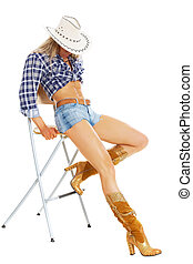 American cowgirl - Portrait of a sexy model posing in...
