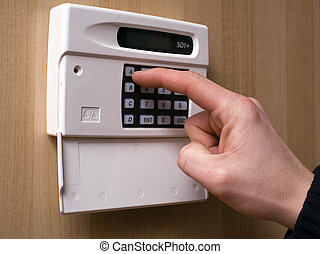Setting an intruder alarm - Image of an intruder alarm being...