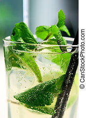 Mojito cocktail closeup with air bubbles - Glass of mojito...