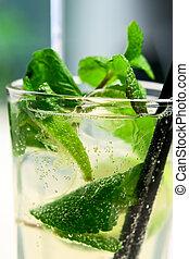 Mojito cocktail closeup with air bubbles - Glass of mojito...
