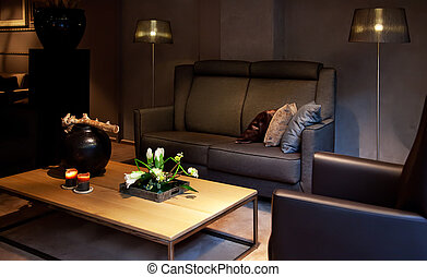 cozy interior with sofa and flowers on table