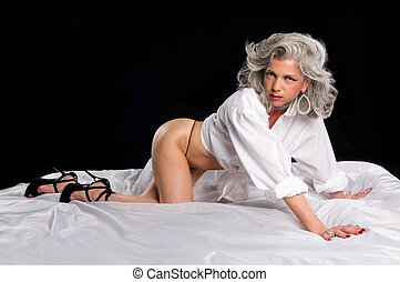 Woman in her bedroom sensual - Very attractive mature woman...