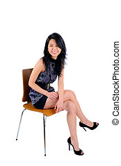 Sitting - Beautiful Young Asian Woman Wearing A Cocktail...