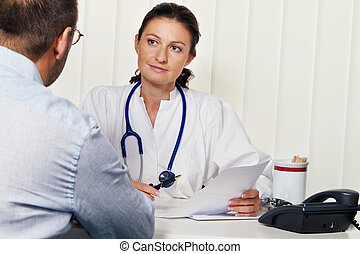 Doctors in medical practice with patients. Discussion for...