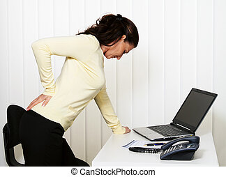 Back pain of the intervertebral disc in office - Woman with...