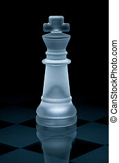 Macro shot of glass chess king against a black background