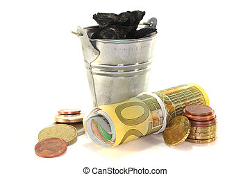 Heating costs - Bucket of coal and euro notes on a white...