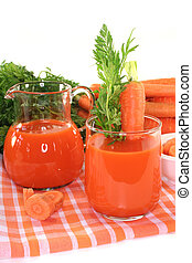 Carrot juice - fresh carrot juice with a bunch of carrots...