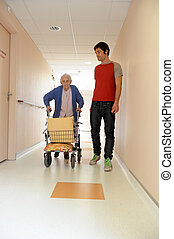 male nurse and senior woman with walking frame - senior...