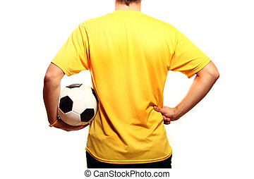 Footballer - A picture of a young footballer in a yellow...