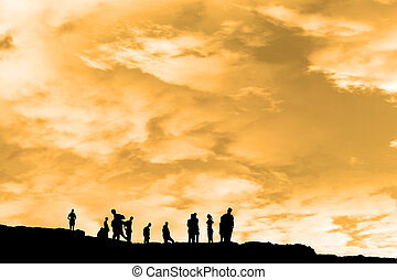 silhouette of people on peak of the cliff edge - Silhouette...