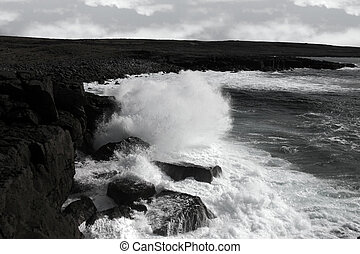 giant storm waves crashing on coastline cliffs - cliffs and...