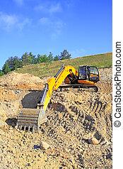 Backhoe loader loading dumper - Excavator loading truck shot...