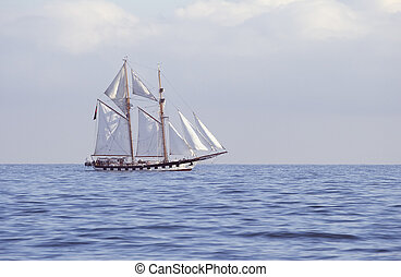 Tall ship in the sea - Ship with white sails in the calm sea