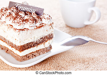 Portion of tiramisu dessert and a cup of coffee
