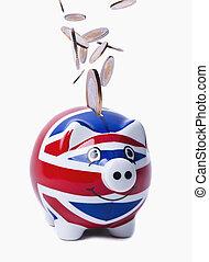 Coins Raining into UK Piggybank