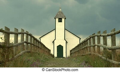 Country Church - Zoom out on small country church with fence